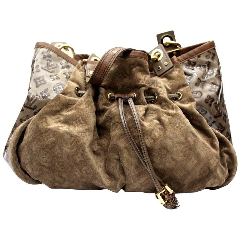 1082e6cbf2d Louis Vuitton Monogram Embossed Suede And Patent Irene Handbag