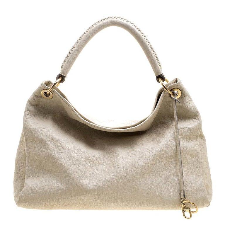 11571d0bf0cb Louis Vuitton Cream Monogram Empreinte Leather Artsy MM Bag at 1stdibs