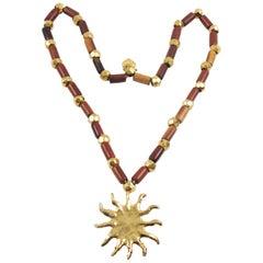 Edouard Rambaud Paris Long Pendant Necklace Wood Gilt Metal Sun Medallion