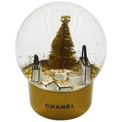 Chanel Snow Globe with Christmas Tree and Shopping Bag operates with Battery