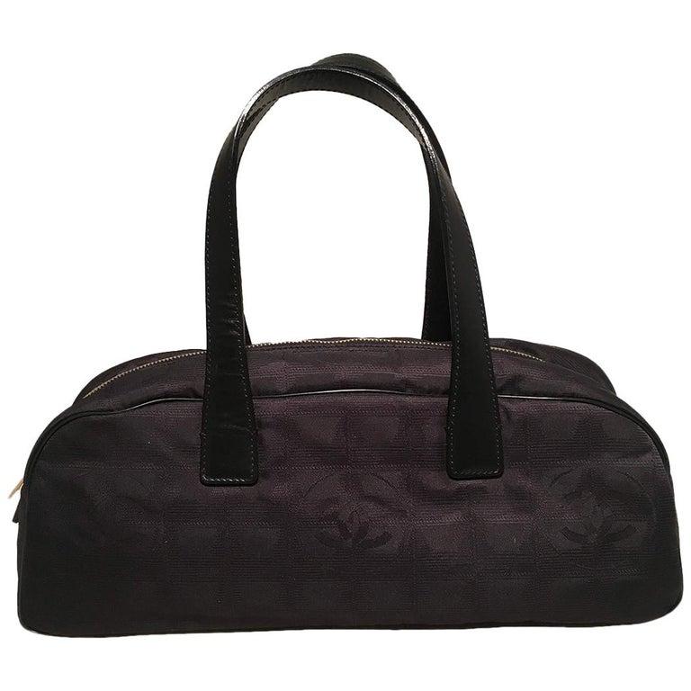 08f4b0ecc4c3 Chanel Black Nylon Traveline Handbag For Sale at 1stdibs