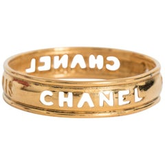 A 1990s Slim Chanel Gold Plated Bangle