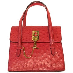 Vintage Celine Red Ostrich bag with golden hardware.
