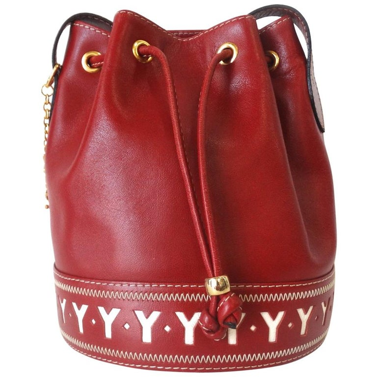 49715900197b 1980s Yves Saint Laurent Red Pebble Leather Bucket Bag For Sale at 1stdibs