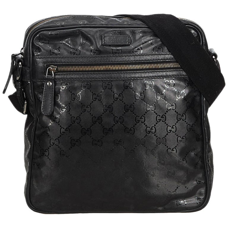 680fad09a81c65 Gucci Black GG Imprime Messenger Bag For Sale. This messenger bag features  a PVC body with leather ...