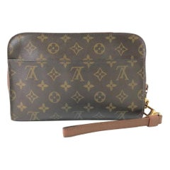 Louis Vuitton Orsay Monogram Wrislet 232062 Brown Coated Canvas Clutch