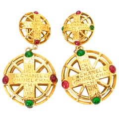 Chanel Golden Pendant Earrings With Red And Green Gems