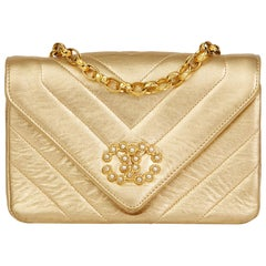 1991 Chanel Gold Chevron Quilted Metallic Lambskin Vintage Pearl Mini Flap Bag