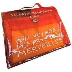 f3c70fd8d42cac Hermès Kelly L'exposition Clear Souvenir 230299 Orange Vinyl Tote
