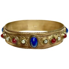 Circa 1920s Austrian Lapis-Blue Glass Cabocon Jeweled Bangle