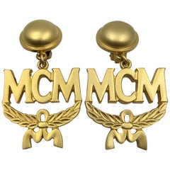 MCM Wreath Logo Matte Gold Tone Clip On Earrings