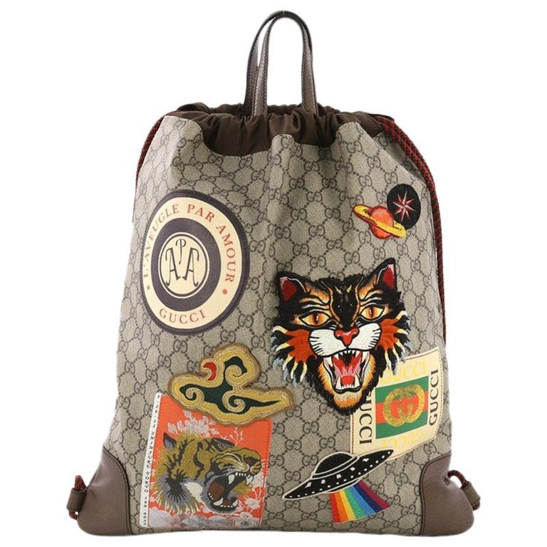 8184cd76de26 Gucci Courrier Soft Drawstring Backpack GG Coated Canvas with Applique  Medium For Sale