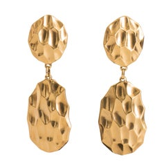 A Pair of 1980s Yves Saint Laurent Gold Plated Drop Clip-on Earrings