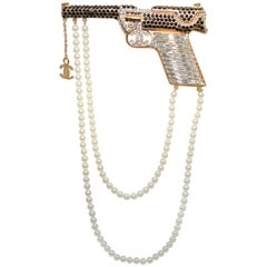 2001 A Chanel Gun Brooch Pin with Rhinestones and Pearls
