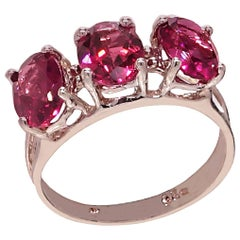 Sparkling Three-Stone Oval Rhodolite Garnet Ring of Sterling Silver