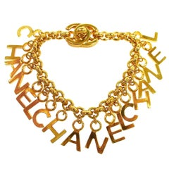 CHANEL Gold Logo 'CHANEL' Chain Charm Dangle Evening Bracelet in Box