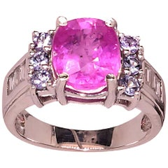 Cocktail Ring of Hot pink oval Sapphire in Tanzanite and Zircon Setting