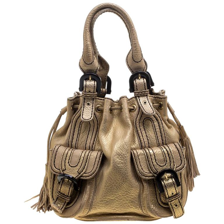 c3ac6bcdf1e Kenzo Gold Leather Drawstring Studded Bucket Bag For Sale at 1stdibs
