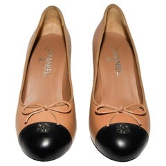Chanel Tan and Black Round Toe With  CC on Cap Toe