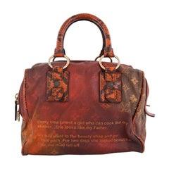 Louis Vuitton Mancrazy Jokes Handbag Monogram Canvas and Snakeskin