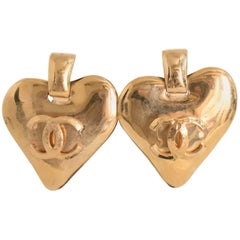 A Pair of Vintage Chanel 1993 Gold Toned Heart Clip On Earrings