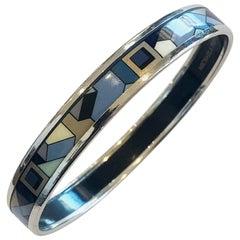 A Michaela Frey Austrian Geometric enamelled bangle in blue and black