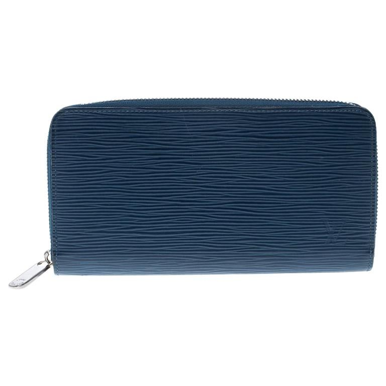 cd3a7f7e737e Louis Vuitton Cyan Epi Leather Zippy Wallet For Sale at 1stdibs