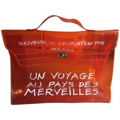 Hermès Kelly 1998 Souvenir D'exposition Clear 230222 Orange Vinyl Messenger Bag