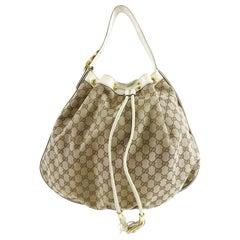 Gucci Interlocking Icon GG Ivory Monogram Canvas Large Drawstring Hobo Bag