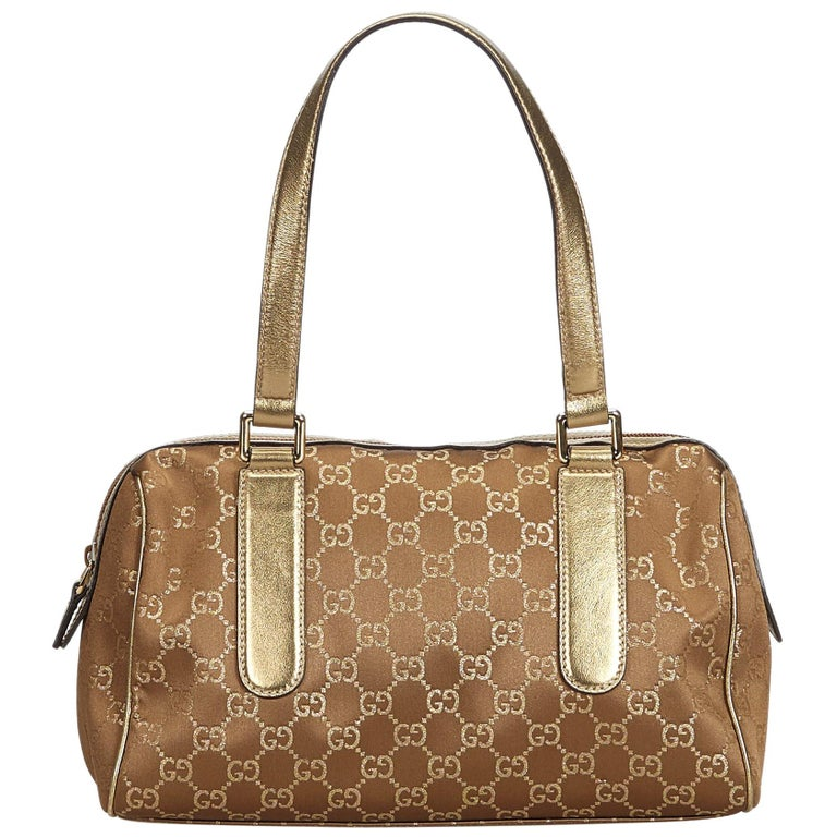368be6c15ace Gucci Brown GG Nylon Charmy Handbag For Sale. The Charmy handbag features a  nylon body with leather trim, flat leather shoulder ...