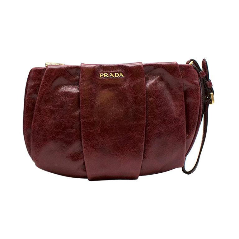 ee20296538 Prada burgundy leather wristlet clutch