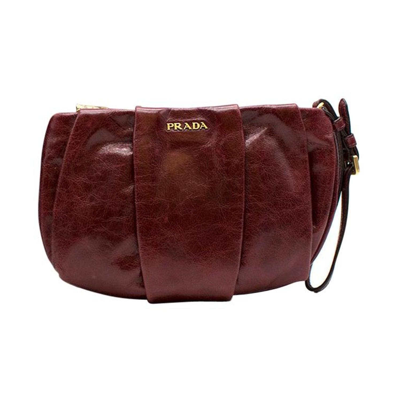 b4251855f8be Prada burgundy leather wristlet clutch at 1stdibs