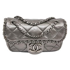 CHANEL Mini Bag in Matte Silver Quilted Leather