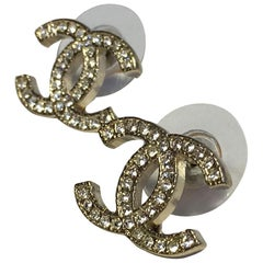 CHANEL CC Stud Earrings in Pale Gilded Metal set with White Rhinestones