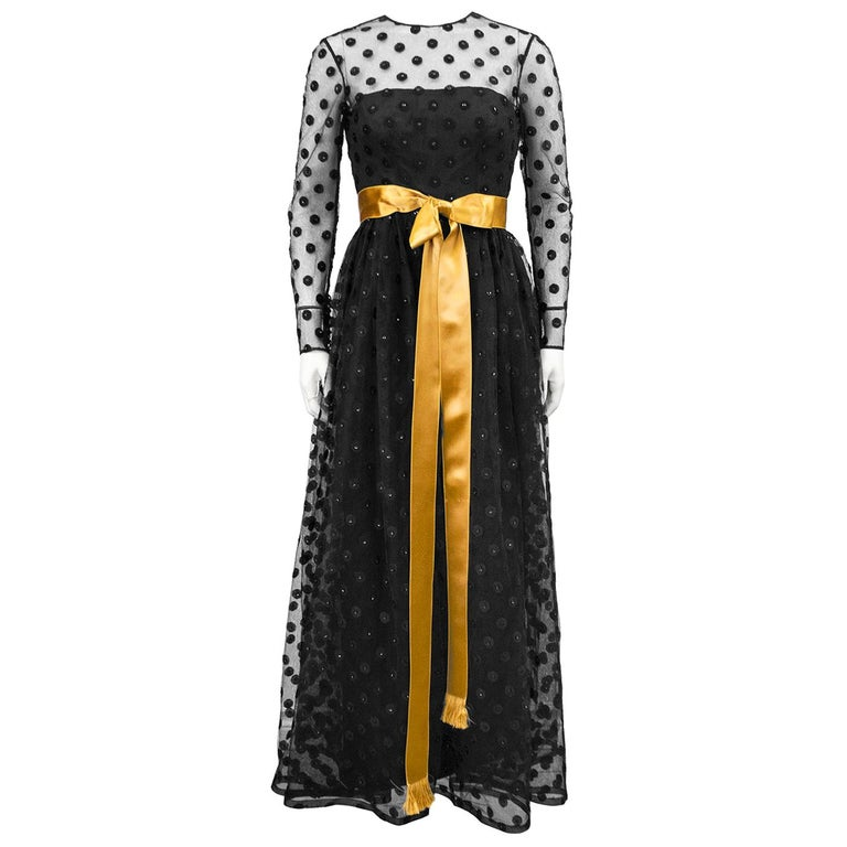 1960s Anonymous Black Long Sleeve Gown with Polka Dot Net Overlay and Gold Sash  For Sale