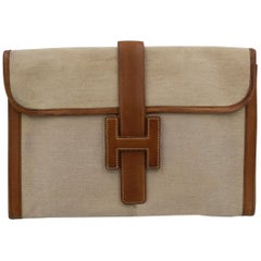 Vintage Hermes Jige MM Clutch in Canvas and Leather.