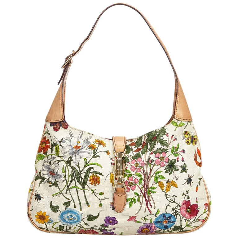 757301abe5be Gucci White Flora New Jackie Shoulder Bag For Sale. The Jackie shoulder bag  features a floral canvas body ...
