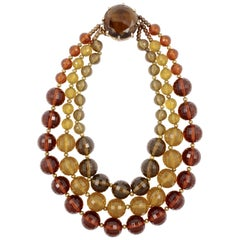 Gold Plated Triple Strand Multi Colored Plastic Bead Necklace with a Glass Clasp