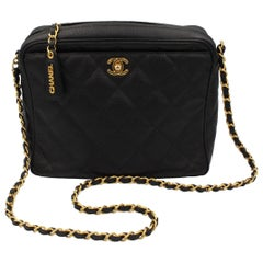 Vintage Chanel black bag in grained leather and golden hardware.