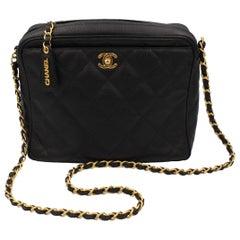 Vintage Chanel black bag in grained leather and golden hardware.