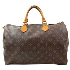 Louis Vuitton Speedy Large Monogram 35 869266 Brown Coated Canvas Satchel