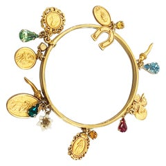 Dolce and Gabbana triple gilt bangle with 16 charms in original box