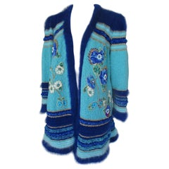 Turquoise coat with flower appliqués
