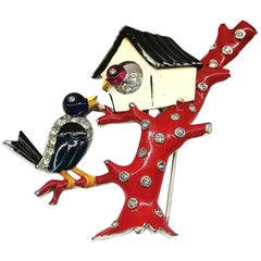 A rare enamelled metal and paste 'Two Birds ' brooch, Trifari, USA, 1930s