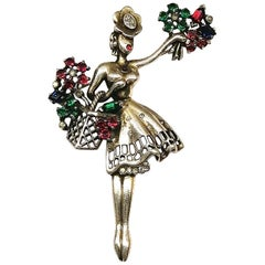 Sterling silver and coloured paste 'flower girl' brooch, Trifari, 1947 , USA