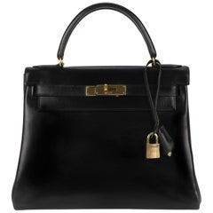 Hermès Kelly 28 in black box calf leather in very good condition!