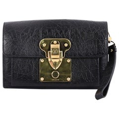 Louis Vuitton Indra Clutch Embossed Leather