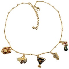 Kenneth Jay Lane Bar Link Charm Necklace in Gold, features Trophy, Car, Golf
