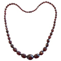 Long Art Deco Cherry Amber faceted bead necklace