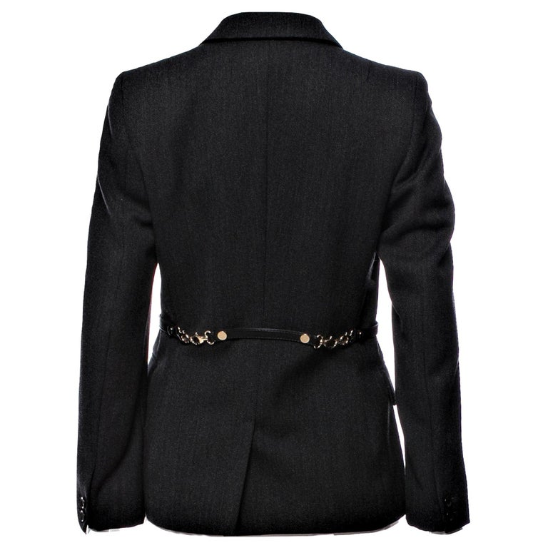 Gucci Runway Ad Blazer Jacket  F/W 2006  Size: IT 44 Roughly U.S. 6 Brand New  $1975 Dark Charcoal Grey  100% Wool Dual Button at Sleeve Gold & Leather Buckle Accent At Back Three Front Pockets Two Button Front Closure Fully Lined In Gucci Signature